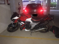 Red And White Mahindra Mojo