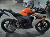 Orange-white Honda CBR 150R
