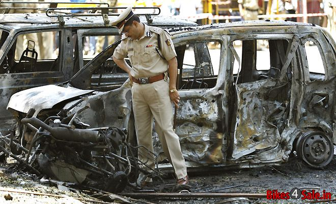 Policeman investigating the bike from the blast taken place at Bangalore