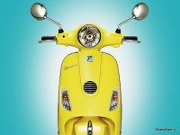 Yellow Vespa LX 125